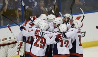 Washington Capitals celebrate after defeating the Tampa Bay Lightning 4-0 in Game 7 of the NHL Eastern Conference finals hockey playoff series Wednesday, May 23, 2018, in Tampa, Fla. (AP Photo/Jason Behnken)