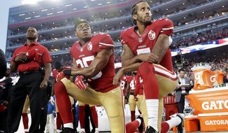 "FILE - In this Monday, Sept. 12, 2016, file photo, San Francisco 49ers safety Eric Reid (35) and quarterback Colin Kaepernick (7) kneel during the national anthem before an NFL football game against the Los Angeles Rams in Santa Clara, Calif. NFL owners have approved a new policy aimed at addressing the firestorm over national anthem protests, permitting players to stay in the locker room during the ""The Star-Spangled Banner"" but requiring them to stand if they come to the field. The decision was announced Wednesday, May 23, 2018,  by NFL Commissioner Roger Goodell during the league's spring meeting in Atlanta. (AP Photo/Marcio Jose Sanchez, File)"