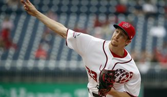 Washington Nationals starting pitcher Erick Fedde throws during the first inning of a baseball game against the San Diego Padres at Nationals Park, Wednesday, May 23, 2018, in Washington. (AP Photo/Alex Brandon)