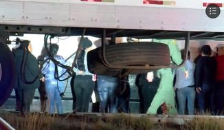 Nearly 100 illegal immigrants tried to escape from a tractor trailer near Raymondville, Texas, on Tuesday, May 22, 2018. (Image: Fox-29 San Antonio screenshot)