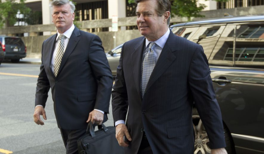 Paul Manafort, President Donald Trump's former campaign chairman, arrives at Federal District Court for a hearing, Wednesday, May 23, 2018, in Washington. ( AP Photo/Jose Luis Magana)