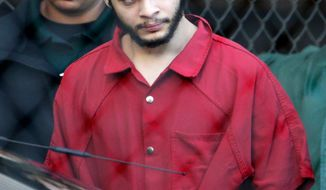 FILE- In this Jan. 30, 2017 file photo Esteban Santiago is escorted from the Broward County jail for an arraignment in federal court in Fort Lauderdale, Fla. Santiago pleaded guilty in exchange for a life prison sentence in the January 2017 Florida airport shooting that killed five people and wounded six. (AP Photo/Lynne Sladky, File)