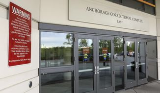 This photo shows the public entrance to the Anchorage Correctional Complex on Wednesday, May 23, 2018, in Anchorage, Alaska. Muslim inmates are suing state corrections officials, claiming that officials at the jail are providing them with inadequate nourishment as they break their daily fasts during Ramadan. (AP Photo/Dan Joling)