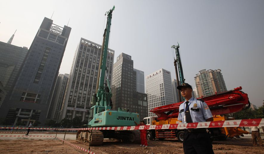 FILE - In this Oct. 26, 2009 file photo, security workers guard at construction site of the U.S. Consulate compound in Guangzhou in southern China's Guangdong province. The State Department said an email notice Wednesday, May 23, 2018, that a U.S. government employee in southern China reported abnormal sensations of sound and pressure, recalling similar experiences among American diplomats in Cuba who later fell ill. (Chinatopix via AP, File)