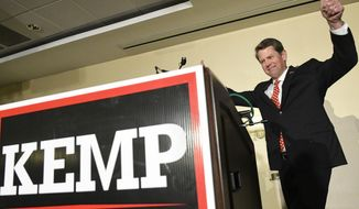 Georgia Secretary of State Brian Kemp, Republican primary candidate for governor approaches the podium to address supporters during an election night results party Tuesday, May 22, 2018, in Athens, Ga. (AP Photo/John Amis)