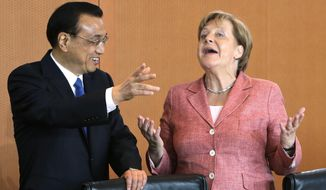 FILE - In this May 31, 2017 file photo German Chancellor Angela Merkel and China's Premier Li Keqiang joke prior to a meeting at the chancellery in Berlin, Germany.     German Chancellor Angela Merkel is heading to China with a business delegation on Wednesday afternoon.  (AP Photo/Ferdinand Ostrop, pool, file)