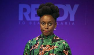 FILE - In this Wednesday April 18, 2018 file photo, Nigerian writer Chimamanda Ngozi Adichie attends the Malaria Summit during the Commonwealth Heads of Government Meeting in London. On Wednesday, May 23, 2018, Adichie addressed Harvard University's graduates at the school's annual pre-commencement Class Day festivities. (Dominic Lipinski/Pool Photo via AP)