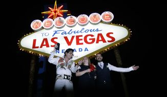 FILE - In this Tuesday, Oct. 3, 2017 file photo, Elvis tribute artist Eddie Powers poses for a photo with newlyweds Rob and Kelly Roznowski after he married them at the Welcome to Las Vegas sign in Las Vegas. What happens in Vegas could have a ripple effect across the country if casino hotel workers go on strike next week. If members of the union that includes hotel and food workers don't show up to work, it could cost the city millions and lead to vacation woes for anyone making the trip to Sin City. (AP Photo/Chris Carlson, File)