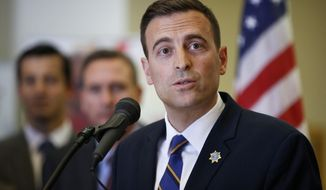 FILE--In this May 15, 2018 file photo, Nevada state Attorney General Adam Paul Laxalt speaks at a news conference in Las Vegas. The front-runner for the Republican gubernatorial nomination, Laxalt has reported raised almost $1.9 million so far in 2018 in addition to at least $1.6 million he carried over from 2017. (AP Photo/John Locher, file)