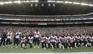 "FILE - In this Oct. 29, 2017, file photo, Houston Texans players kneel and stand during the singing of the national anthem before an NFL football game against the Seattle Seahawks, in Seattle. NFL owners have approved a new policy aimed at addressing the firestorm over national anthem protests, permitting players to stay in the locker room during the ""The Star-Spangled Banner"" but requiring them to stand if they come to the field. The decision was announced Wednesday, May 23, 2018, by NFL Commissioner Roger Goodell during the league's spring meeting in Atlanta. (AP Photo/Elaine Thompson, File) **FILE**"