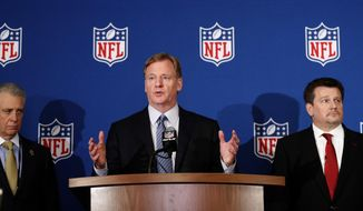 NFL commissioner Roger Goodell, center, is flanked by Pittsburgh Steelers president Art Rooney II, left, and Arizona Cardinals owner Michael Bidwill during a news conference where he announced that NFL team owners have reached agreement on a new league policy that requires players to stand for the national anthem or remain in the locker room, during the NFL owner's spring meeting Wednesday, May 23, 2018, in Atlanta. (AP Photo/John Bazemore) **FILE**