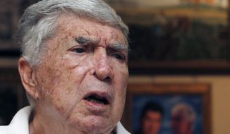 FILE - In this Nov. 8, 2010, file photo, Luis Posada Carriles talks in Miami. Posada Carriles was long suspected of organizing a string of Havana hotel bombings in 1997 and the 1976 bombing of a Cuban jetliner that killed 73. Posada Carriles died Wednesday, May 23, 2018, in Miami. He was 90 years old. (AP Photo/Alan Diaz, File)