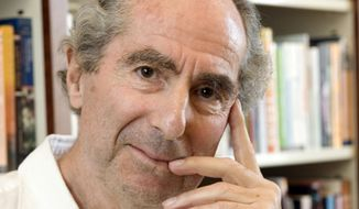 In this Sept. 8, 2008, file photo, author Philip Roth poses for a photo in the offices of his publisher, Houghton Mifflin, in New York. Roth, prize-winning novelist and fearless narrator of sex, religion and mortality, has died at age 85, his literary agent said Tuesday, May 22, 2018. (AP Photo/Richard Drew, File)