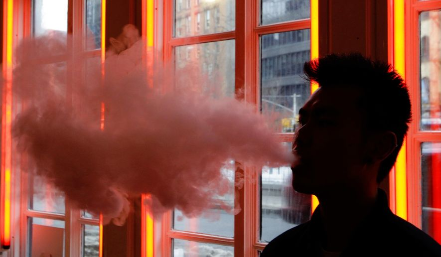 Use of electronic cigarettes has reached epidemic levels among minors and is an unacceptable trade-off for helping adults wean off regular cigarettes, the Food and Drug Administration says. (Associated Press/File)