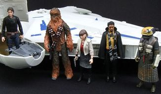 "Hasbro's ""Solo: A Star Wars Story"" Kessel Run Millennium Falcon along with some of the Force Link 2.0, 3.75-inch action figure collection that includes Han Solo, Chewbacca, Corellia Qi'ra, Lando Calrissian and a Kessel Guard. (Photograph by Joseph Szadkowski / The Washington Times)"