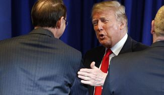Immigration and Customs Enforcement director Thomas Homan, right, watches as Deputy Attorney General Rod Rosenstein shakes hands with President Donald Trump during a roundtable on immigration policy at Morrelly Homeland Security Center, Wednesday, May 23, 2018, in Bethpage, N.Y. (AP Photo/Evan Vucci)