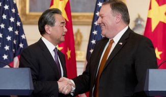Secretary of State Mike Pompeo and Chinese State Councilor and Foreign Minister Wang Yi shake hands following a news conference at the State Department, Wednesday, May 23, 2018, in Washington. (AP Photo/Andrew Harnik)