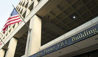 In this Nov. 2, 2016, file photo, the FBI's J. Edgar Hoover headquarters building in Washington. (AP Photo/Cliff Owen, File)