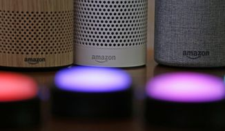 FILE - In this Wednesday, Sept. 27, 2017, file photo, Amazon Echo and Echo Plus devices, behind, sit near illuminated Echo Button devices during an event announcing several new Amazon products by the company, in Seattle. As people get voice-activated speakers and online security cameras for convenience and peace of mind, are they also giving hackers a key to their homes? Many devices from reputable manufacturers have safeguards built in, but safeguards arent the same as guarantees. (AP Photo/Elaine Thompson, File)