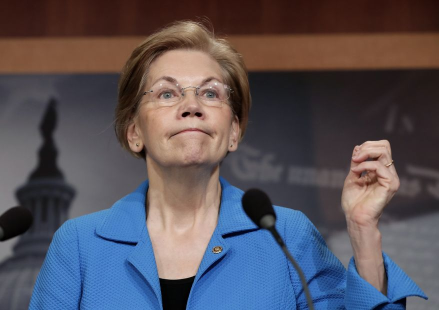Sen. Elizabeth Warren, D-Mass., addresses reporters during a news conference at the Capitol in Washington, Tuesday, March 6, 2018. (AP Photo/J. Scott Applewhite) ** FILE **