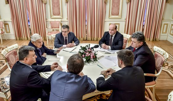 George Soros, second left, chairman of Soros Fund Management and founder of The Open Society Institute, speak with Ukrainian President Petro Poroshenko, right, in Kiev, Ukraine, Tuesday, Jan. 13, 2015. (AP Photo/Mykola Lazarenko, Pool) **FILE**