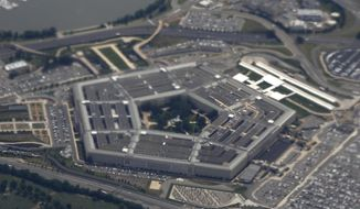 In this June 3, 2011, file photo, the Pentagon is seen from air from Air Force One. (AP Photo/Charles Dharapak, File)