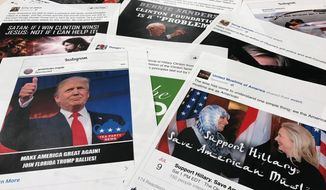 This Nov. 1, 2017, file photo shows some of the Facebook and Instagram ads linked to a Russian effort to disrupt the American political process and stir up tensions around divisive social issues, released by members of the U.S. House Intelligence committee, are photographed in Washington. (AP Photo/Jon Elswick, File)