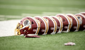 Washington Redskins football helmets are seen during an NFL football team practice, Wednesday, May 23, 2018, in Ashburn, Va. (AP Photo/Nick Wass) ** FILE **