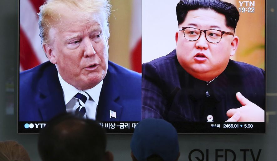 People watch a TV screen showing file footage of U.S. President Donald Trump, left, and North Korean leader Kim Jong Un during a news program at the Seoul Railway Station in Seoul, South Korea, Thursday, May 24, 2018. North Korea carried out what it said is the demolition of its nuclear test site Thursday, setting off a series of explosions over several hours in the presence of foreign journalists. (AP Photo/Ahn Young-joon)