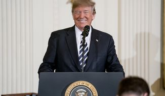 "President Donald Trump smiles during a ceremony to award the Medal of Honor to Master Chief Special Warfare Operator Britt K. Slabinski in the East Room of the White House in Washington, Thursday, May 24, 2018. Slabinski oversaw a daring 2002 assault and rescue mission on a snowy Afghanistan mountaintop and carried a ""seriously wounded teammate down a sheer cliff face"" while leading ""an arduous trek across one kilometer of precipitous terrain, through waist-deep snow while continuing to call fire on the enemy."" (AP Photo/Andrew Harnik)"