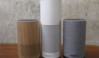 "FILE - In this Sept. 27, 2017, file photo, Amazon Echo Plus, center, and other Echo devices sit on display during an event announcing several new Amazon products by the company in Seattle. Amazon says an ""unlikely"" string of events prompted its Echo personal assistant device to record a Portland, Ore., family's private conversation and then send the recording to an acquaintance in Seattle. (AP Photo/Elaine Thompson, File)"