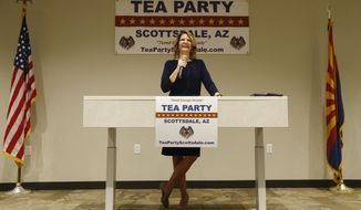 In this May 17, 2018, photo, Republican Senate candidate Kelli Ward talks about her platform policies at a Scottsdale Tea Party event in Scottsdale, Ariz. Arizona conservatives are torn between two icons of their movement - former Sheriff Joe Arpaio and former state senator Ward - in the GOP Senate primary. (AP Photo/Ross D. Franklin)