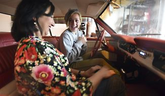 Layne Pachl screams for joy as she sits next to Sandi Elder in the car that Elder gave her in Greeley, Colo., May 18, 2018. The surprise car was a token of appreciation given to Pachl for her kidney donation to Elder. (Joshua Polson/The Greeley Tribune via AP)