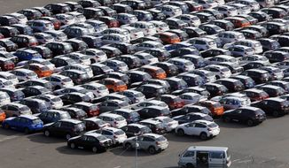 FILE - In this Dec. 20, 2012 photo, cars for export park at a port in Kawasaki, west of Tokyo. China and Japan both condemned Thursday, May 24, 2018 the Trump administration's decision to launch an investigation into whether tariffs are needed on imports of vehicles and automotive parts into the United States. (AP Photo/Koji Sasahara, File)