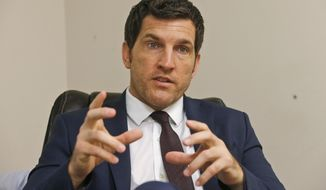 """In this Friday, Oct. 7, 2016, photo, Virginia's 2nd District Congressman Scott Taylor speaks during an interview in his campaign office in Virginia Beach, Va. Taylor, a former sniper in Iraq, who is running in the June 12 primary, won his first term by nearly 23 percentage points in 2016. Taylor said he's skeptical that anyone who """"regurgitates Washington Democrat talking points"""" can win his district. (AP Photo/Steve Helber)"""