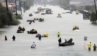 FILE - In this Aug. 28, 2017, file photo rescue boats float on a flooded street as people are evacuated from rising floodwaters brought on by Tropical Storm Harvey. U.S. government forecasters are expecting an active Atlantic hurricane season. The National Oceanic and Atmospheric Administration forecast released Thursday, May 24, 2018, calls for about 10 to 16 named storms, with about five to nine hurricanes. (AP Photo/David J. Phillip, File)