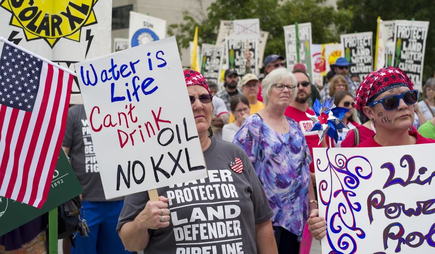 In this Aug. 6, 2017, file photo, demonstrators against the Keystone XL listen to speakers in Lincoln, Neb. (AP Photo/Nati Harnik, File)