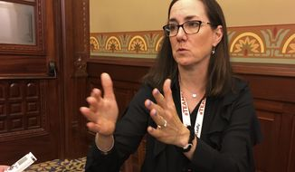 Chicago Democratic state Rep. Kelly Cassidy speaks to a reporter about her legislation to legalize the use of marijuana for pain to replace opioids at the Capitol in Springfield, Ill., Thursday, May 24, 2018. Cassidy has said the process for investigating ethics complaints in the Legislature should be overhauled. (AP Photo/John O'Connor)