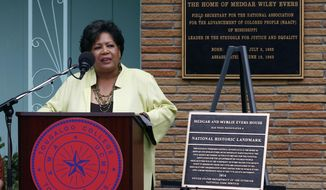 Reena Evers-Everett, daughter of civil rights leaders Medgar and Myrlie Evers, delivers reflections on behalf of her family before the National Park Service presented a bronze plaque, right, showing the Jackson, Miss., Evers' home as a national historic landmark, Thursday, May 24, 2018. As the Mississippi NAACP's first field secretary beginning in 1954, Medgar Evers led voter registration drives and boycotts to push for racial equality. He was assassinated in June 1963 outside the family's modest ranch-style home. (AP Photo/Rogelio V. Solis)