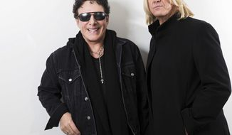 In this Jan. 23, 2018 photo, Journey lead guitarist Neal Schon, left, and Def Leppard singer Joe Elliot appear in New York to promote their 60-show tour this summer. While both bands have continued to make new music, expect the tour to focus on the hits. (Photo by Brian Ach/Invision/AP)