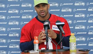 Seattle Seahawks quarterback Russell Wilson talks to reporters following NFL football practice, Thursday, May 24, 2018, in Renton, Wash. (AP Photo/Ted S. Warren)