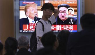 "People watch a TV screen showing file footage of U.S. President Donald Trump, left, and North Korean leader Kim Jong Un during a news program at the Seoul Railway Station in Seoul, South Korea, Thursday, May 24, 2018. North Korea carried out what it said is the demolition of its nuclear test site Thursday, setting off a series of explosions over several hours in the presence of foreign journalists.The signs read: "" North Korea demolishes nuclear test site ."" (AP Photo/Ahn Young-joon)"