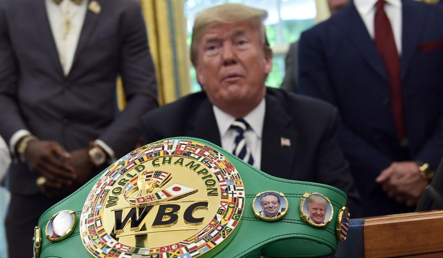 A boxing belt presented to President Donald Trump, sits on the desk in the Oval Office of the White House in Washington, Thursday, May 24, 2018, where Trump granted a posthumous pardon to Jack Johnson, boxing's first black heavyweight champion. (AP Photo/Susan Walsh) ** FILE **
