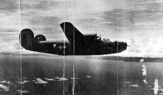 "This circa 1943 U.S. Army Air Force photo from the Kelly Family Research Project shows the ""Heaven Can Wait"" B-24 bomber, location unknown, in which Lt. Thomas Kelly died when it was shot down in Hansa Bay in what is now Papua New Guinea during World War II. When Tom Kelly's relatives got word that his bomber had been found, a wave of exhilaration mixed with grief washed over family members. Although relatives who never met Kelly had pieced much of his life story together over the years, they never knew what happened when his plane was shot down off the coast of Papua New Guinea in 1944. They got their answer recently when the group Project Recover found the B-24 bomber under 213 feet of water. (U.S. Army Air Force/Kelly Family Research Project via AP)"