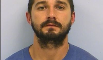 This booking photo provided by the Austin Police Department shows Shia LaBeouf. Actor Shia LaBeouf has been arrested and charged with public intoxication after an incident in Austin, Texas. The Austin Police Department said in a news release that LaBeouf was arrested at 7:33 p.m. Friday, Oct. 9, 2015. Jail records show he was booked into the Travis County Jail and released on his own recognizance. (Austin Police Department via AP)