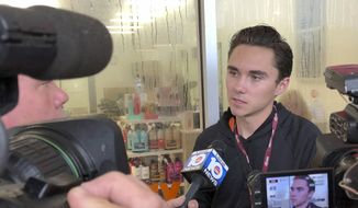 "David Hogg, a student at Marjory Stoneman Douglas speaks outside a Publix Supermarket in Coral Springs, Fla., Friday, May 25, 2018. Students from the Florida high school where 17 people were shot and killed earlier this year plan a ""die in"" protest at a supermarket chain that backs a gubernatorial candidate allied with the National Rifle Association. Shortly before the the ""die-in "" Publix announced that is will suspect political donations. (AP Photo/Terry Spencer)"