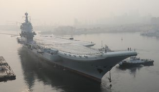 FILE - In this May 13, 2018, file photo, provided by China's Xinhua News Agency, China's aircraft carrier leaves Dalian in northeast China's Liaoning Province for sea trials. Chinese navy pilots aboard the country's sole operating aircraft carrier have completed their first nighttime takeoffs and landings. The missions are being hailed as a major step forward in the Liaoning's combat ability. (Li Gang/Xinhua via AP, File)
