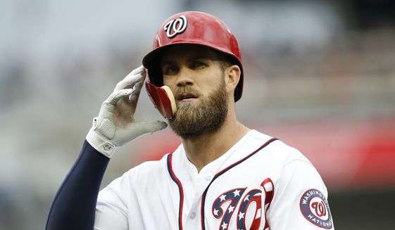In this May 5, 2018, file photo, Washington Nationals' Bryce Harper walks off the field after grounding out during the fifth inning of a baseball game against the Philadelphia Phillies at Nationals Park in Washington. (AP Photo/Carolyn Kaster, File) **FILE**