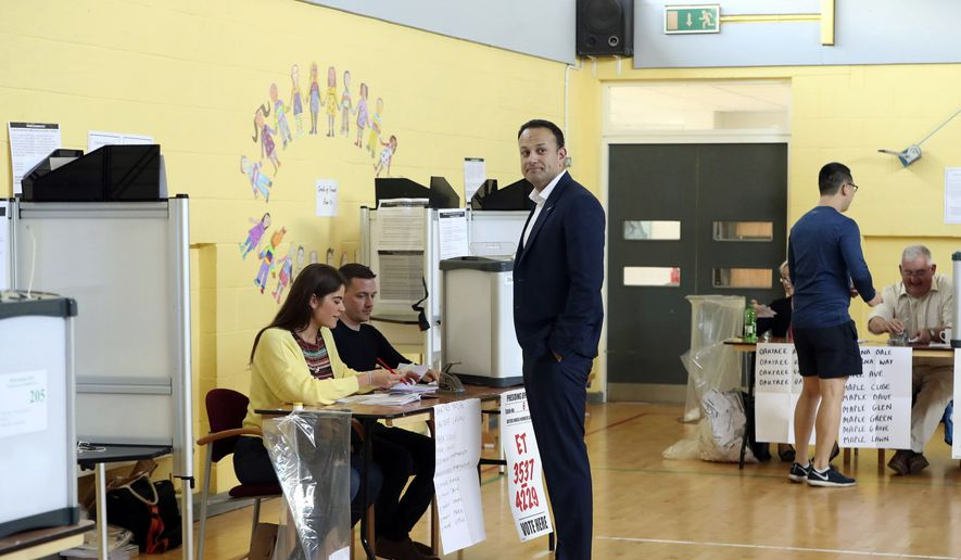 Ireland's Prime Minister Leo Varadkar waits to cast his vote at a polling station as the country goes to the polls to vote in the referendum on the 8th Amendment of the Irish Constitution, in Dublin, Friday, May 25, 2018. Voters throughout Ireland have begun casting votes in a referendum that may lead to a loosening of the country's strict ban on most abortions. (Niall Carson/PA via AP)