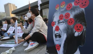 """Protesters attend a rally to denounce the United States' policies against North Korea near the U.S. embassy in Seoul, South Korea, Friday, May 25, 2018. North Korea said Friday that it's still willing to sit down for talks with the United States """"at any time, at any format"""" just hours after President Donald Trump abruptly canceled his planned summit with the North's leader Kim Jong Un. (AP Photo/Ahn Young-joon)"""